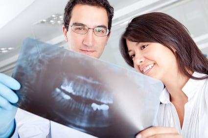 Dentist looking at an x-ray at the hospital